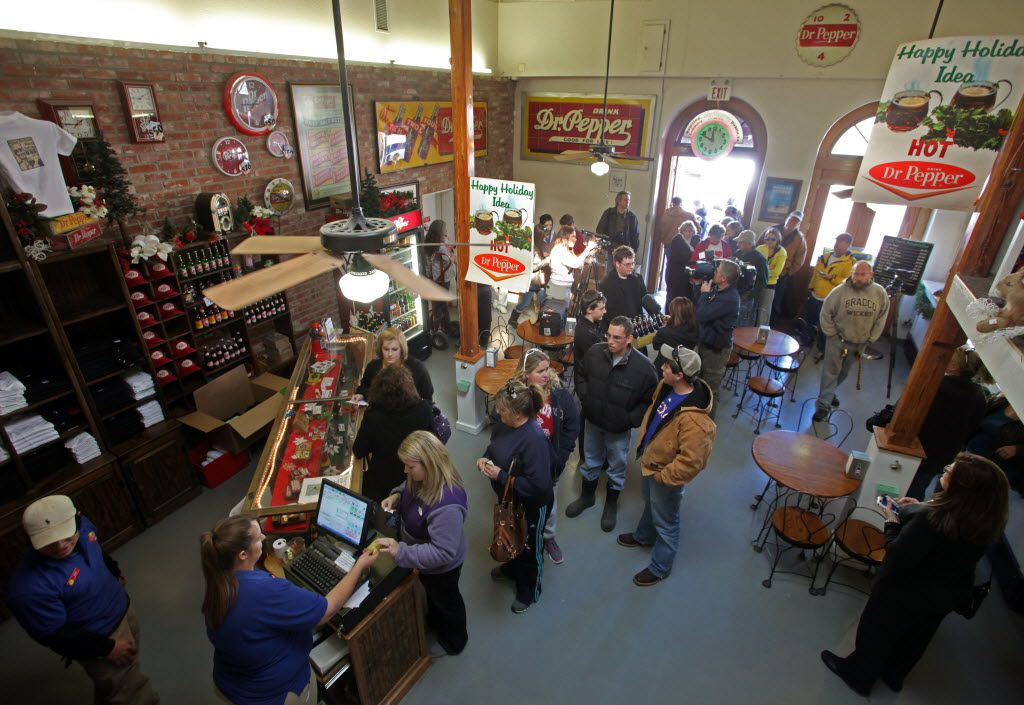 Crowds gather on the last day to get Dublin Dr Pepper after the Dr Pepper Bottling Co. of Dublin agreed to a settlement in a trademark infringement case on Jan. 12, 2012.  (File Photo/Nathan Hunsinger/The Dallas Morning News)