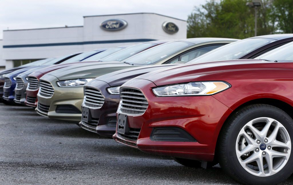 A row of Ford Fusions on display at an automobile dealership in Pennsylvania.  (AP Photo/Keith Srakocic, File)