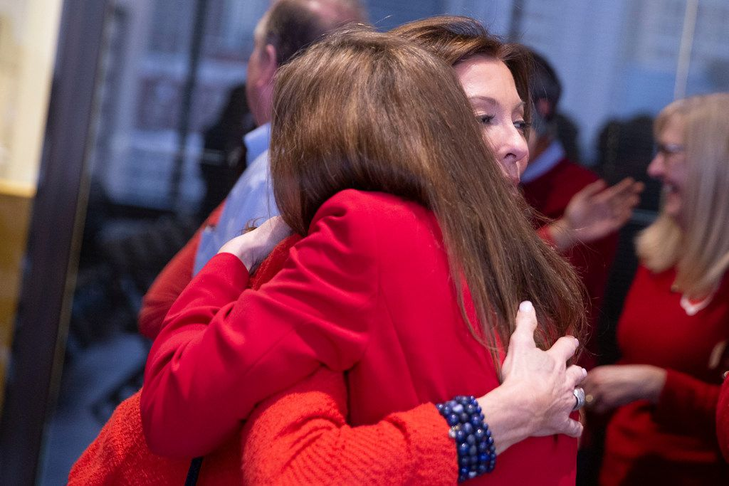 Charlotte Jones-Anderson, chair of the Salvation Army's National Advisory Board, embraces zoning attorney Angela Hunt after the plan commission approved the proposal in a 13-1 vote last month.