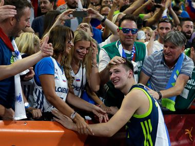 In this Sept. 14, 2017, file photo, Slovenia's Luka Doncic celebrates with the supporters at the end of their European Basketball Championship semifinal match against Spain, in Istanbul.