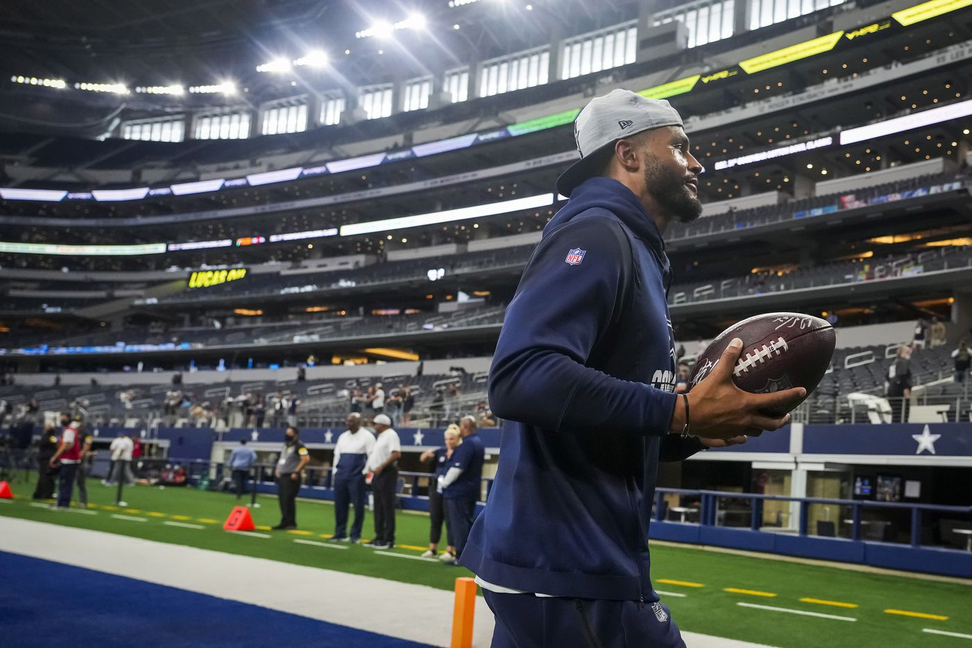 Dallas Cowboys quarterback Dak Prescott prepares to toss a ball to a fan as the team warms up before a preseason NFL football game against the Jacksonville Jaguars at AT&T Stadium on Sunday, Aug. 29, 2021, in Arlington. (Smiley N. Pool/The Dallas Morning News)