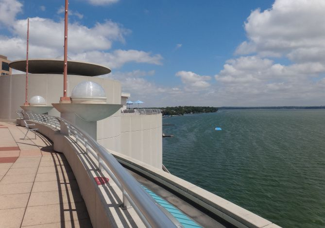 Monona Terrace's broad garden-laden deck overlook's Madison's Lake Monona. The striking building was originally designed by Frank Lloyd Wright.