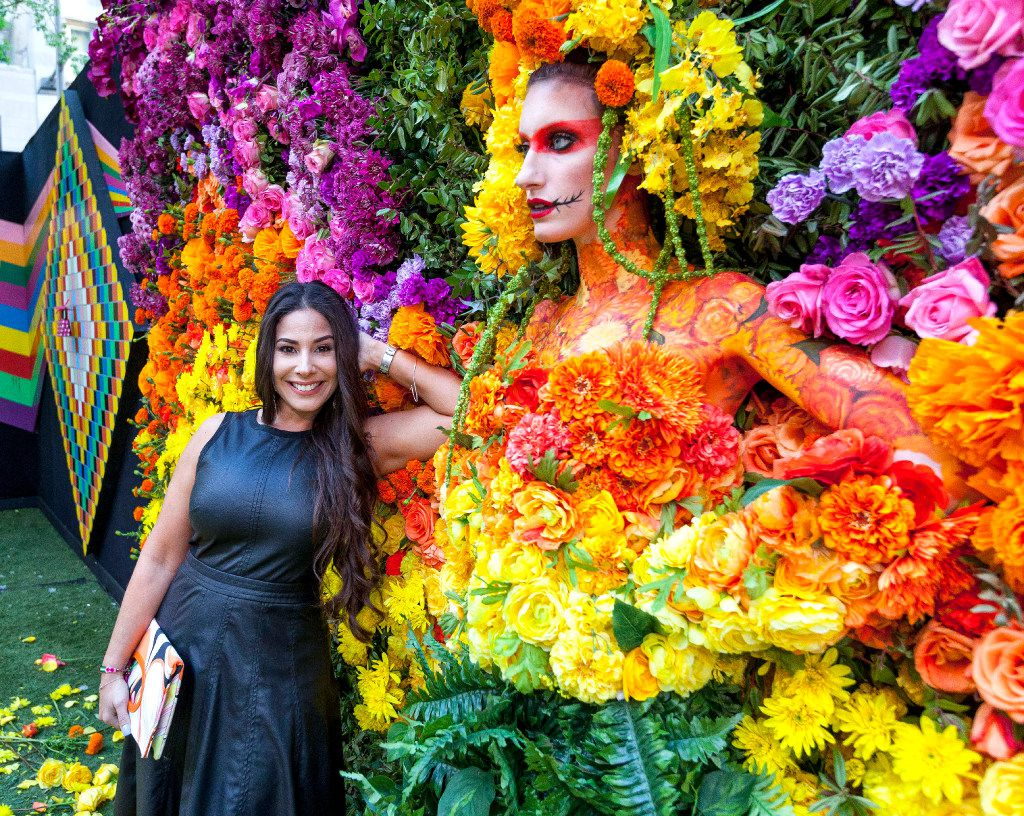 Liza Krengenl poses with the floral wall at the Eye Ball Party celebrating the Dallas Art Fair in Dallas, Saturday, April 8, 2017. (Ron Heflin/Special Contributor)  ORG XMIT: RFH101