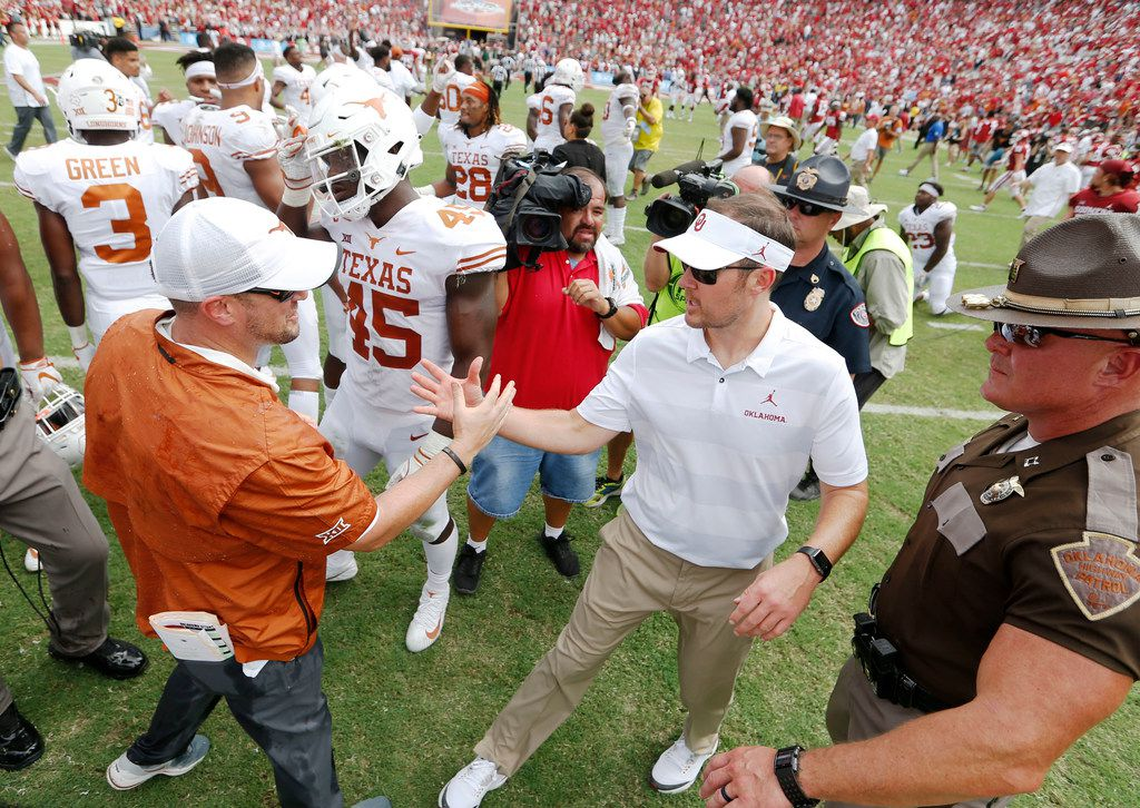 Texas Longhorns head coach Tom Herman and Oklahoma Sooners head coach Lincoln Riley greet each other after the game at the Cotton Bowl in Dallas on Saturday, October 6, 2018. Texas Longhorns defeated Oklahoma Sooners 48-45. (Vernon Bryant/The Dallas Morning News)