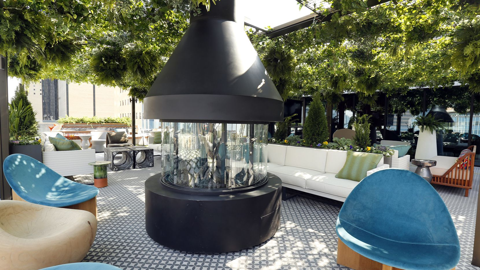 A large fireplace and funky furniture are pictured on the Catbird outdoor patio area of the 219-room Thompson Dallas luxury hotel. (Tom Fox/The Dallas Morning News)
