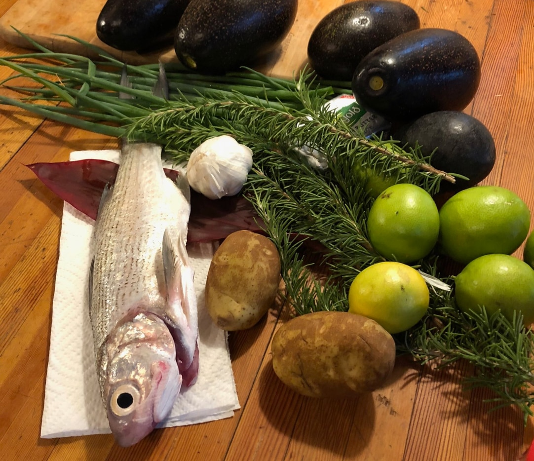 Dinner is cooking! Moi (a type of Threadfish native to Hawaiian waters) is prepped to be served with potatoes and avocado.