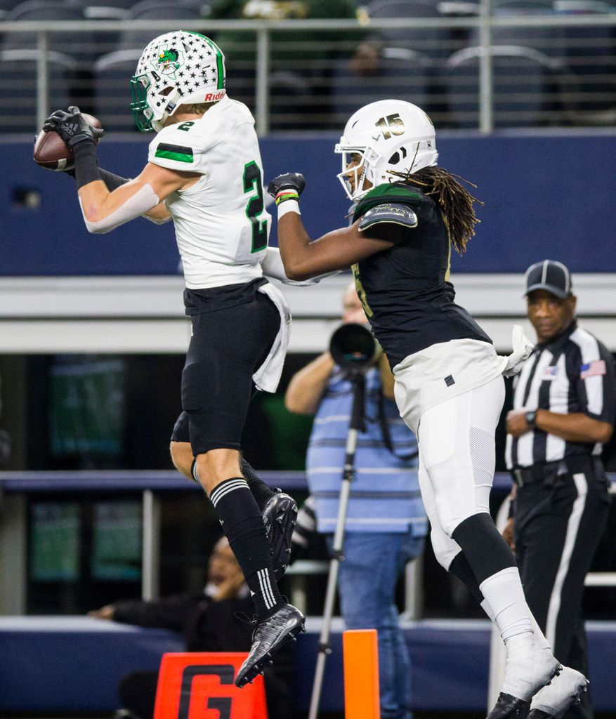 Southlake Carroll defensive back Dylan Thomas (2) intercepts a pass intended for DeSoto tight end Javon Charles (15) during the fourth quarter of a Class 6A Division I area-round high school football playoff game between Southlake Carroll and DeSoto on Friday, November 22, 2019 at AT&T Stadium in Arlington. (Ashley Landis/The Dallas Morning News)