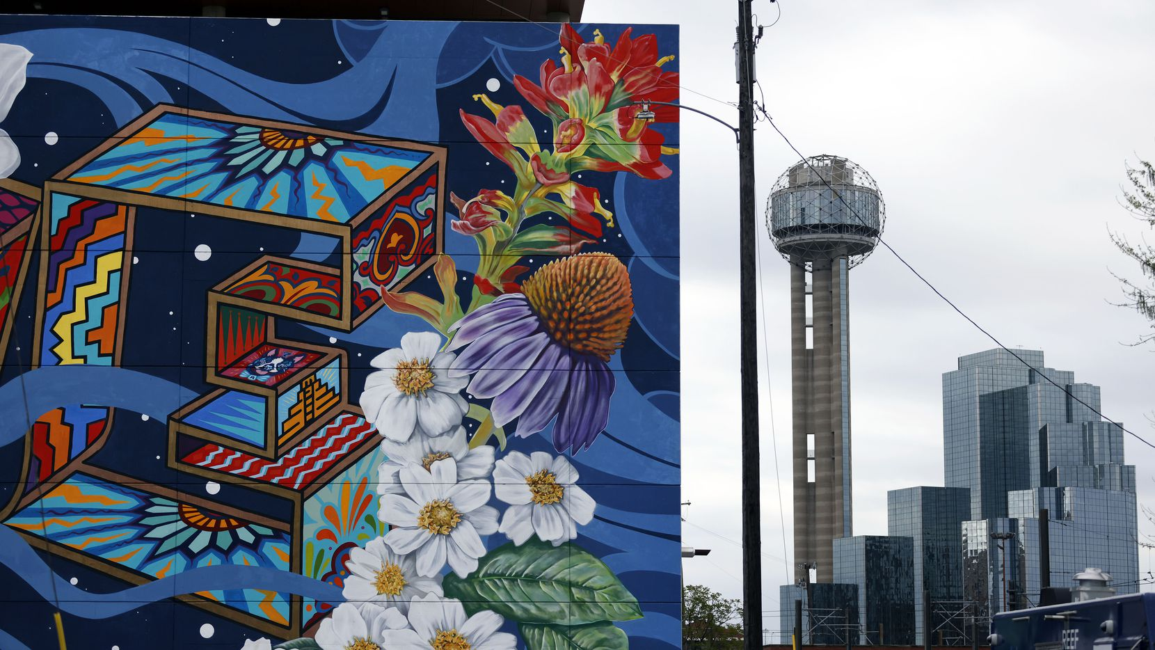 The Power of Love mural is painted on the north side of the Luminary Building in downtown Dallas' West End.