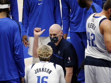 Dallas Mavericks head coach Rick Carlisle talks with his players during a timeout during the first quarter of a preseason game with the Minnesota Timberwolves at the American Airlines Center in Dallas, Thursday, December 17, 2020.