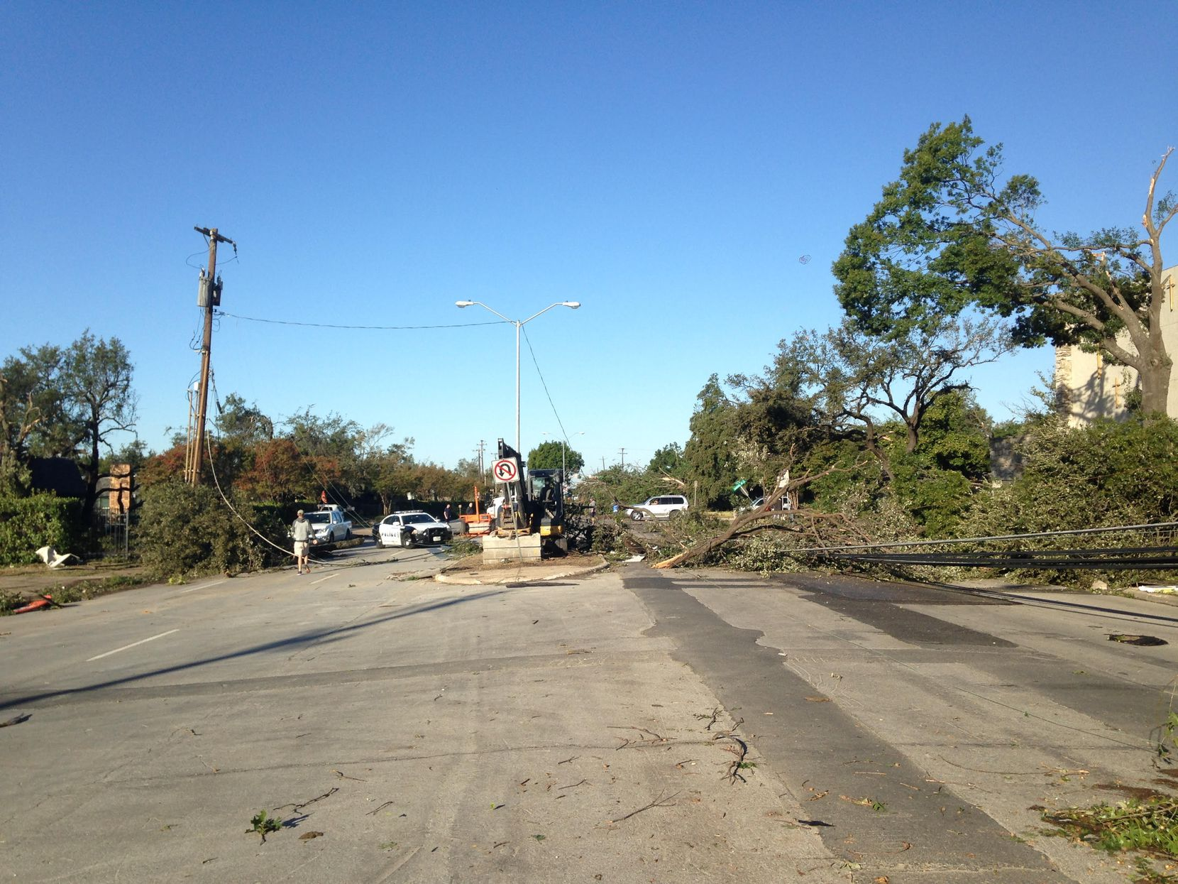 Looking west down Royal Lane near Preston Road, where power lines were downed by Sunday's tornado.