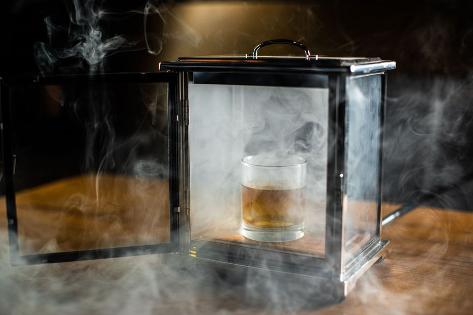 Beverage director Alex Fletcher created a cigar-smoked Old-Fashioned cocktail, which diners can order from both Ounce and Ichi Ni San at the AT&T Discovery District.
