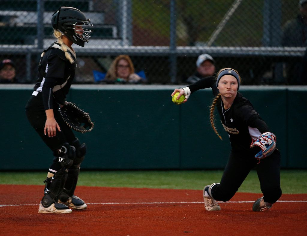 The Colony's Madison Hirsch, right, throws the ball to first next to catcher Jacee Hamlin Prosper during a softball game against Prosper at Prosper High School in Prosper, Texas, Tuesday, March 20, 2018. (Jae S. Lee/The Dallas Morning News)