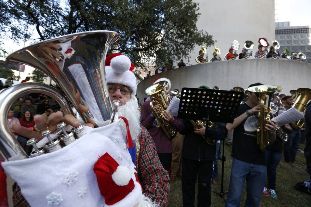 Warren Brooks from Fairview, Texas, plays the euphonium during a TubaChristmas concert at Thanksgiving Square in Dallas