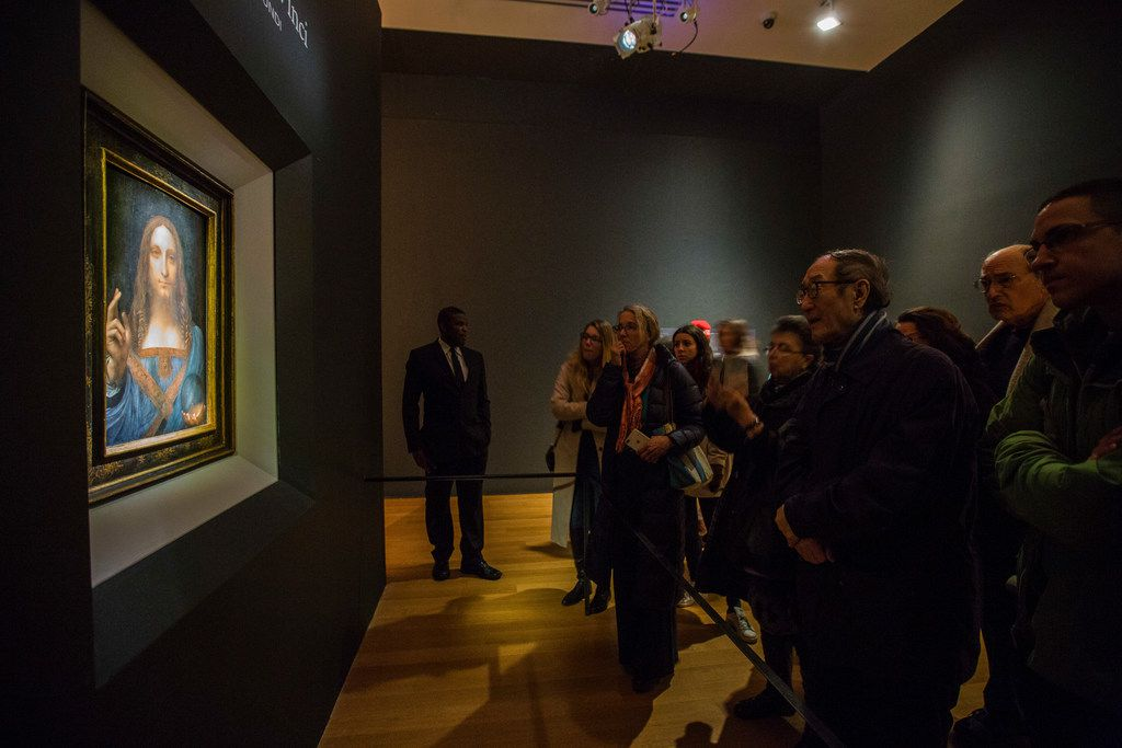 """Leonardo da Vinci's """"Salvator Mundi"""" (Savior of the World) is viewed at Christie's in Manhattan, Nov. 13, 2017. Some 27,000 people on three continents lined up for pre-auction viewings to glimpse the only known painting by the Renaissance master in private hands. The auction was set for the night of Nov. 15. (Benjamin Norman/The New York Times)"""