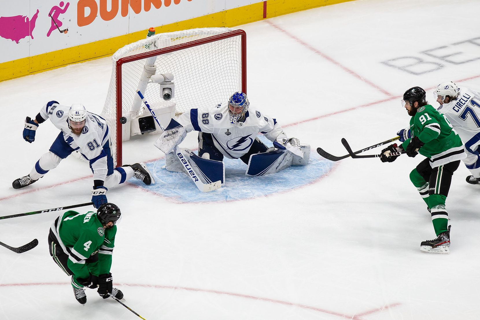 Miro Heiskanen (4) and Tyler Seguin (91) of the Dallas Stars attack the net as goaltender Andrei Vasilevskiy (88) of the Tampa Bay Lightning makes a save during Game Three of the Stanley Cup Final at Rogers Place in Edmonton, Alberta, Canada on Wednesday, September 23, 2020. (Codie McLachlan/Special Contributor)