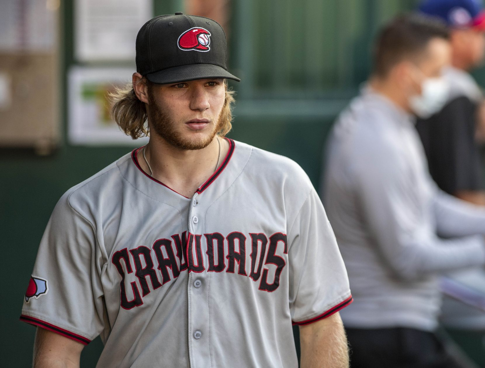 Hickory Crawdad's pitcher Zak Kent (11) walks in the dugout during the game with the Greensboro Grasshoppers at First National Bank Field on Thursday, August 5, 2021 in Greensboro, N.C.