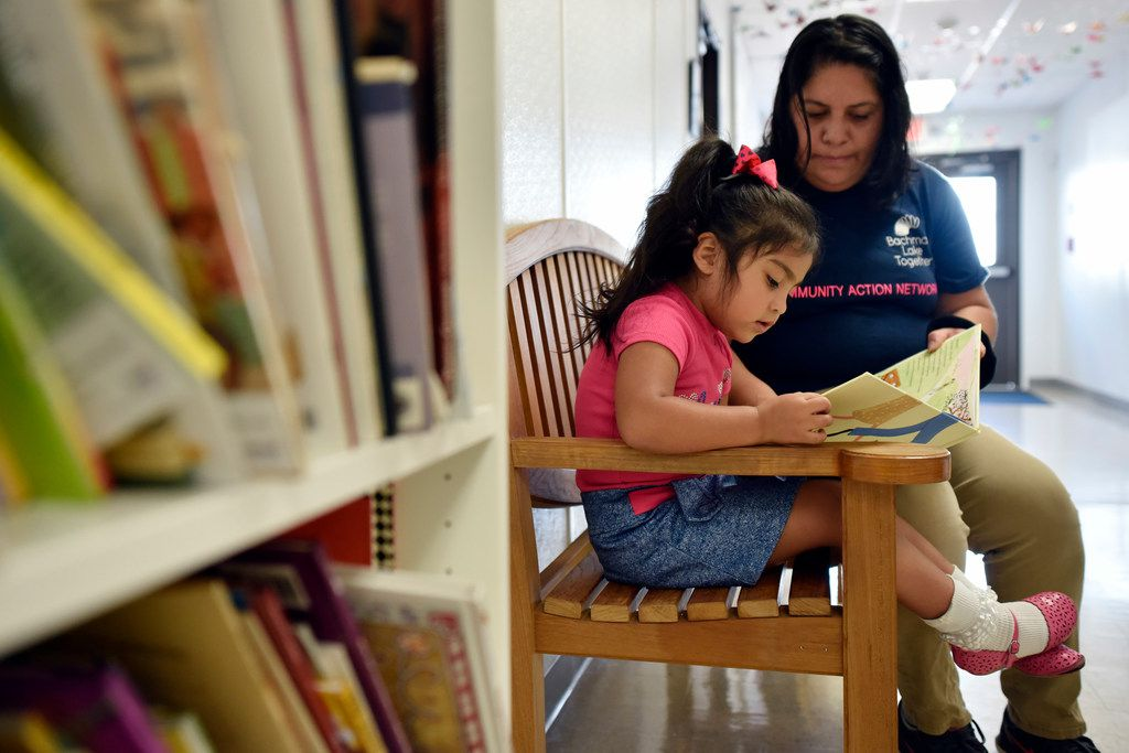 Patricia Vega works with her daughter Elizabeth Diaz on educational activities to help her before she enters pre-K at the Bachman Lake Together Family Center in Dallas. (Ben Torres/Special Contributor)