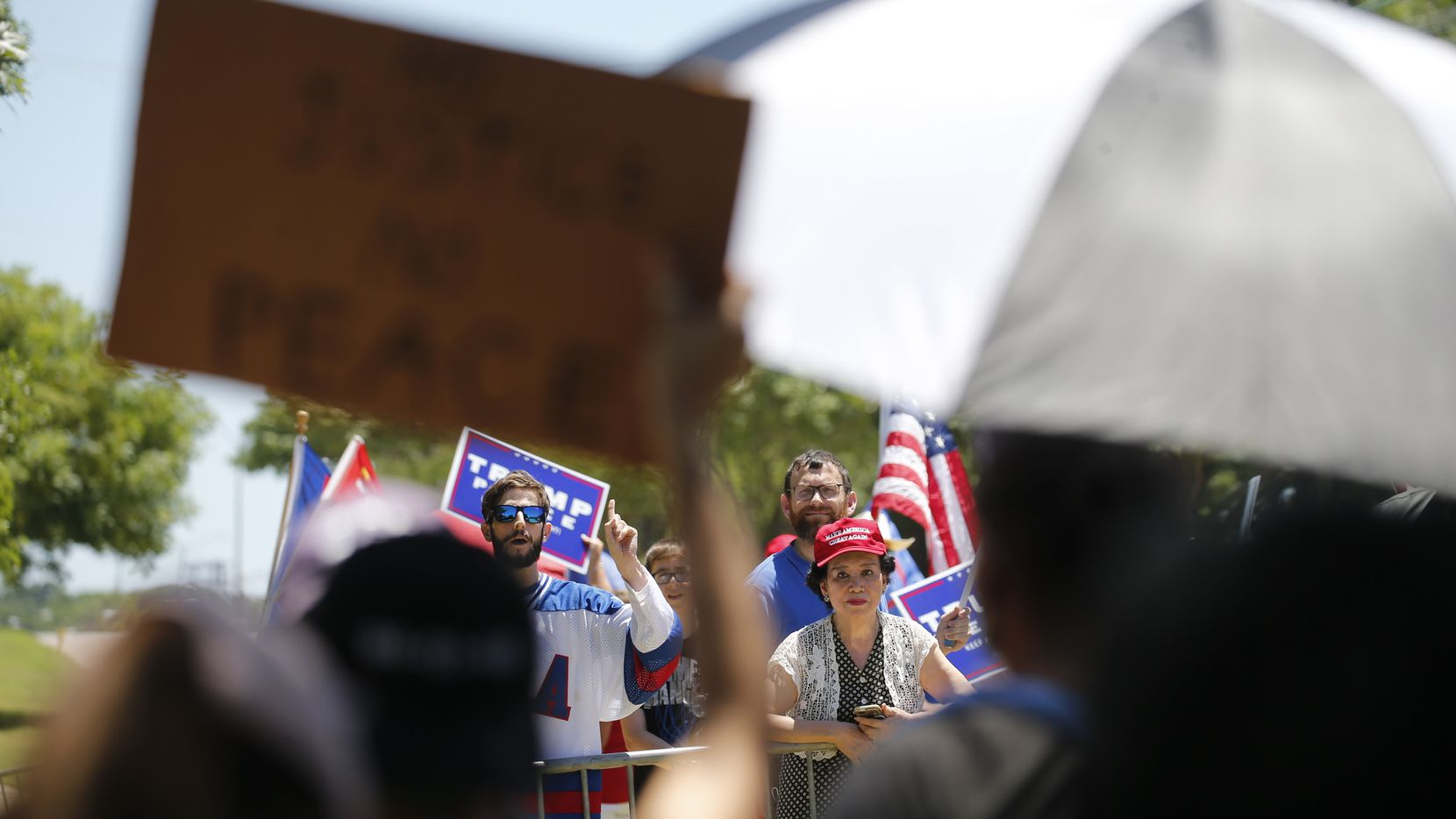 Protesters chant at each other near Gateway Church in Dallas on Thursday.