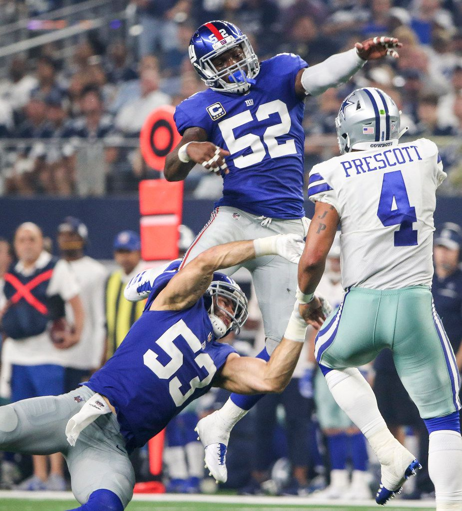New York Giants linebacker Alec Ogletree (52) and linebacker Connor Barwin (53) attempt to block a pass by Dallas Cowboys quarterback Dak Prescott (4) during the Dallas Cowboys 20-13 win over the New York Giants on Sunday, Sept. 16, 2018 at AT&T Stadium in Arlington, Texas. (Ryan Michalesko/The Dallas Morning News)