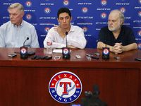 Texas Rangers owners Ray Davis, left, and Bob Simpson, right, flank President of Baseball Operations and General Manager Jon Daniels at a news conference at Globe Life Park in Arlington, Texas, on Sept. 5, 2014. (Richard W. Rodriguez/Fort Worth Star-Telegram/TNS)