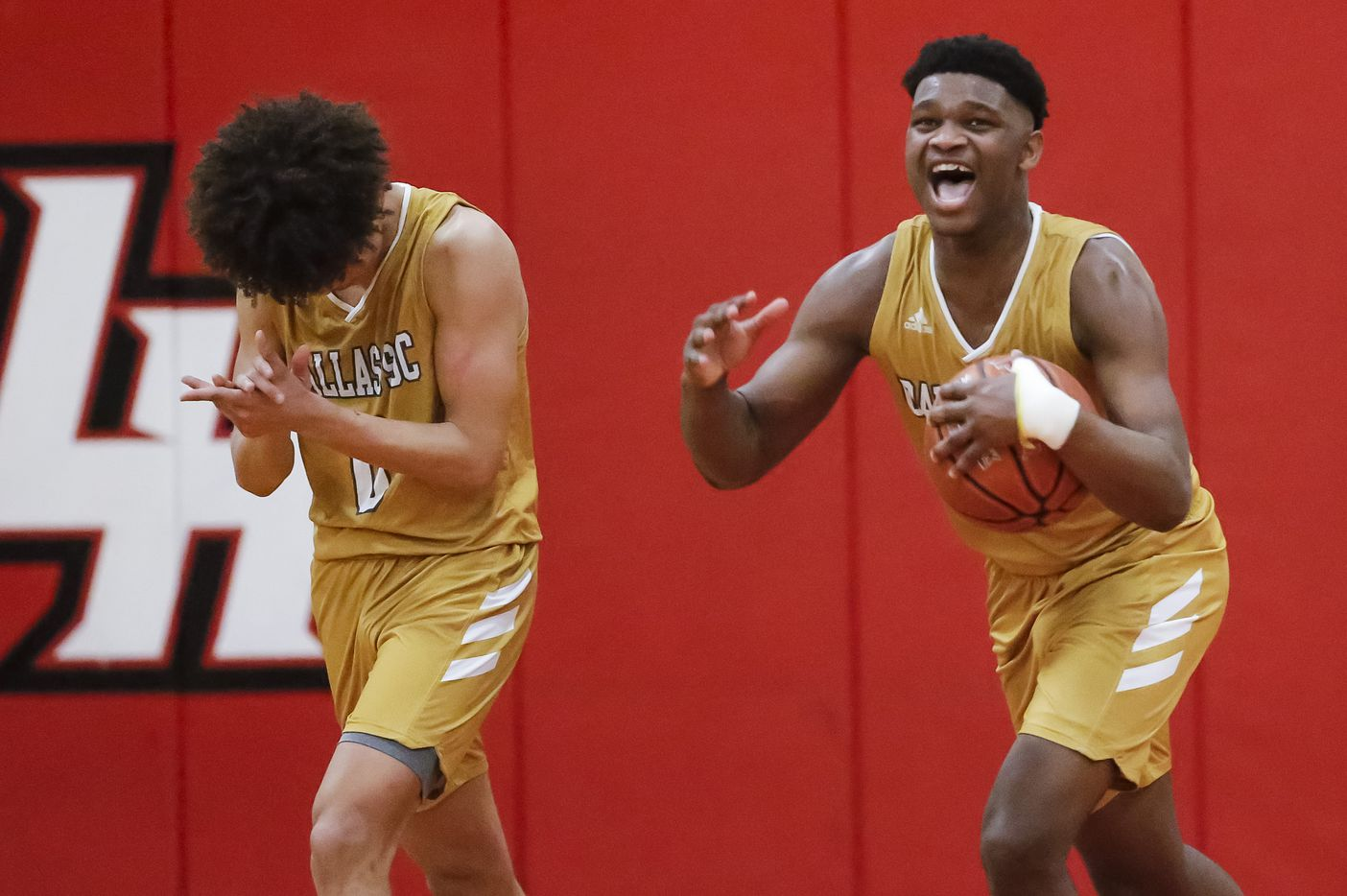South Oak Cliff senior guard Antoneo Pavia (0) and senior forward Antonio Patterson, right, celebrate a 46-44 win over Lovejoy after a Class 5A area-round playoff basketball game at Lake Highlands High School in Dallas, Wednesday, February 24, 2021. (Brandon Wade/Special Contributor)
