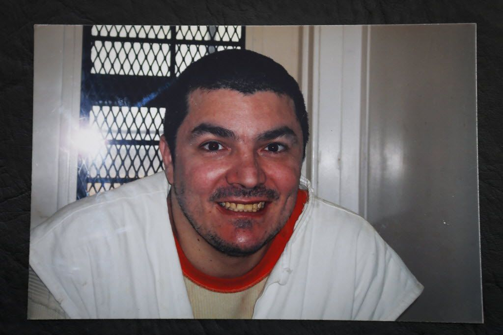 Victor Saldano smiles for the camera while on death row.