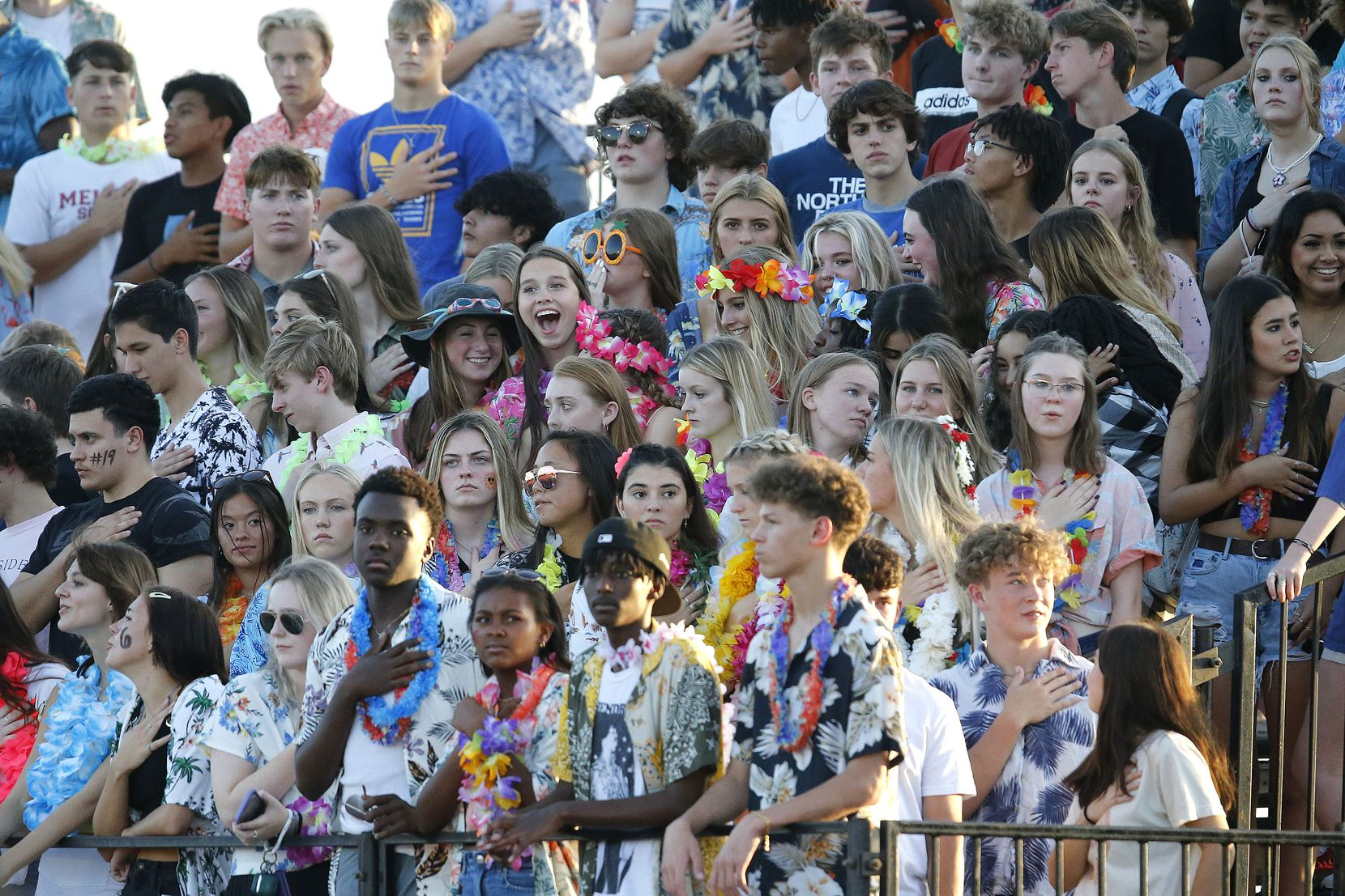 The Melissa High School student section stands at attention during the national anthem as Melissa High School hosted Celina High School at Cardinal Field in Melissa on Friday night, August 27, 2021. (Stewart F. House/Special Contributor)