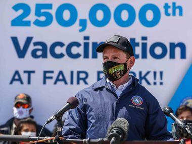 Dallas County Judge Clay Jenkins celebrates the 250,000th vaccination provided by Dallas County at Fair Park in Dallas on March 30, 2021. (Lola Gomez/The Dallas Morning News)