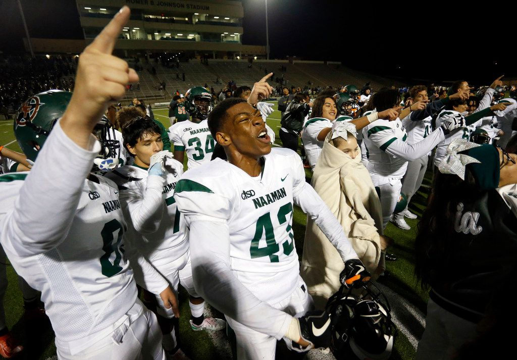 Naaman Forest players, including Nick Abengowe (43), celebrate their 42-27 win over Lakeview Centennial in a high school football game at Homer B. Johnson Stadium on Friday, November 8, 2019. (John F. Rhodes / Special Contributor)
