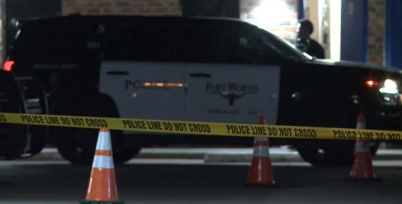 Crime tape marks the spot near where three people were injured in a drive-by shooting Monday night in Fort Worth.
