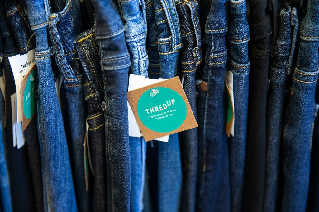 Jeans sit on the shelves in the thredUP section at J.C. Penney inside the Timber Creek Crossing shopping center in Dallas on Tuesday, August 20, 2019.  J.C. Penney and many other traditional retailers are turning to partnerships with companies like thredUP to add used clothing to their mix. ThredUP is a resale website for costumers buying secondhand clothings.  (Shaban Athuman/Staff Photographer)