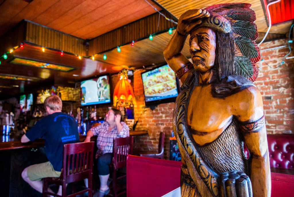 A wooden chief statue salutes at The Elbow Room. (Ashley Landis/The Dallas Morning News)