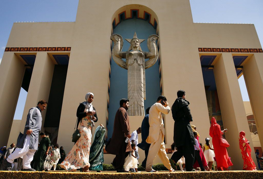 Muslims leave the Centennial Building at Fair Park after gathering for prayer during Eid al-Fitr, celebrating the end of Ramadan, Wednesday, July 6, 2016 in Dallas. Ramadan is the Islamic holy month of fasting. (Tom Fox/The Dallas Morning News)