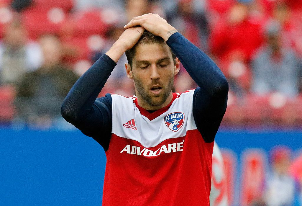 FC Dallas midfielder Ryan Hollingshead (12) holds his head in disbelief after missing a shot on goal during the first half as FC Dallas hosted the New York Red Bulls at Toyota Stadium in Frisco on Saturday, May 11, 2019.  (Stewart F. House/Special Contributor)