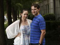 Brianna Connaughton and Rex Simmons pose for a portrait outside their home in Plano on July 29. Simmons and his fianceé, Connaughton, filed a lawsuit against Walters Wedding Estates because their wedding was canceled due to COVID-19 concerns and the venue will not give them back their money.