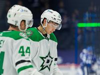 TAMPA, FL - MAY 5: Joel Hanley #44 and Jason Robertson #21 of the Dallas Stars react to the loss against the Tampa Bay Lightning during the third period at Amalie Arena on May 5, 2021 in Tampa, Florida.