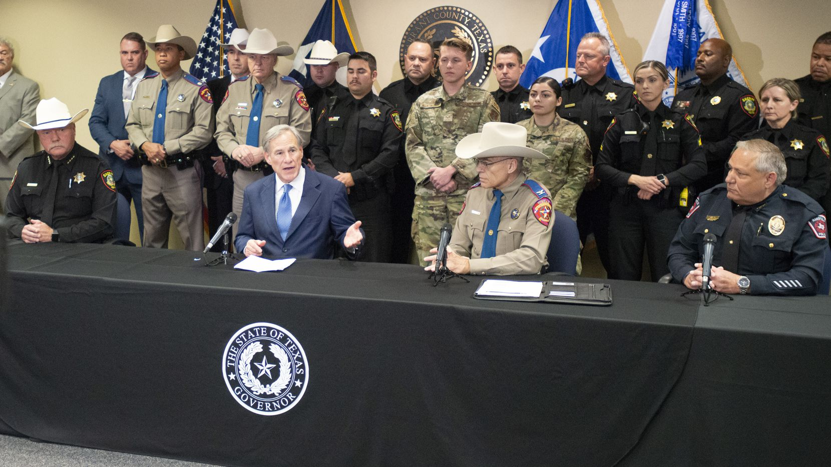 Backed by Department of Public Safety officers, Tarrant County Sheriff's Deputies and Texas national guard members Texas Governor Greg Abbott addresses the media during a May 27, 2021 press conference at the Tarrant County Sheriff's office in Fort Worth, Texas to provide an update on the state's effort to secure the border and prevent the smuggling of dangerous drugs into Texas. (Robert W. Hart/Special Contributor)