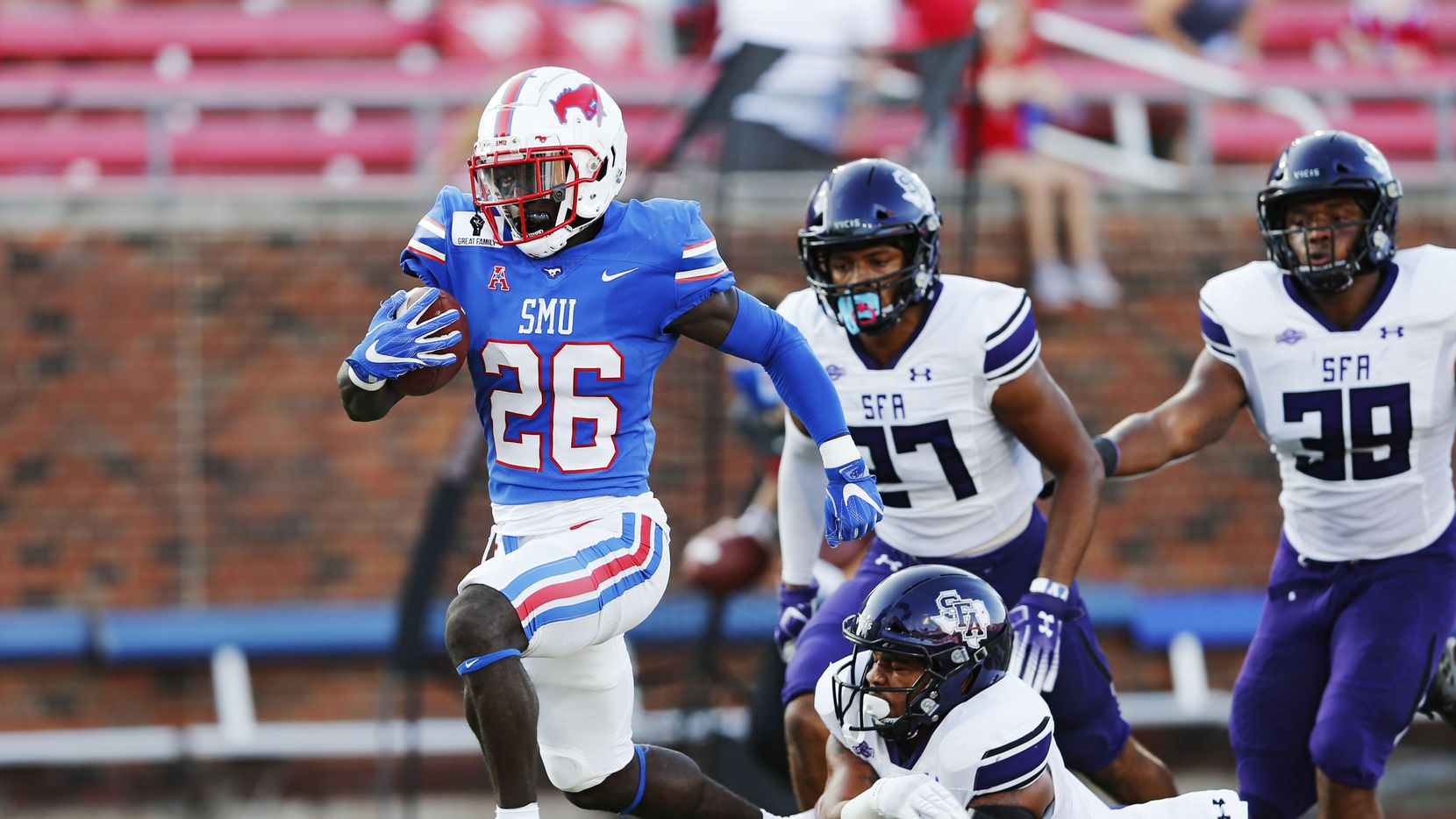 SMU running back Ulysses Bentley IV (26) evades Stephen F. Austin linebacker Brevin Randle (6) for a touchdown during the first half of a game at Ford Stadium in Dallas on Saturday, Sept. 26, 2020.