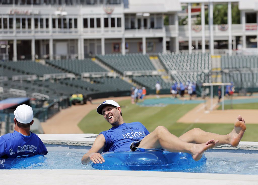 Dallas Mavericks player Dirk Nowitzki visited with Charlie McKinney, founder of the annual Heroes Celebrity Baseball Game, in the lazy river after training camp for Dirk Nowitzki's 2016 Heroes Celebrity Baseball Game at Dr Pepper Ballpark in Frisco in June 2016.
