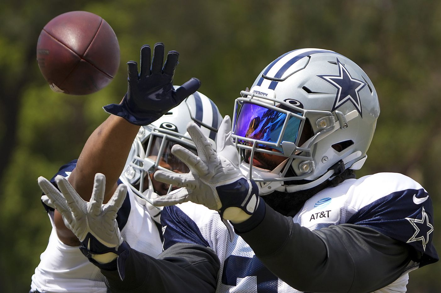 Dallas Cowboys running back Ezekiel Elliott catches a pass in a drill as running back Tony Pollard defends during a practice at training camp on Wednesday, Aug. 11, 2021, in Oxnard, Calif.