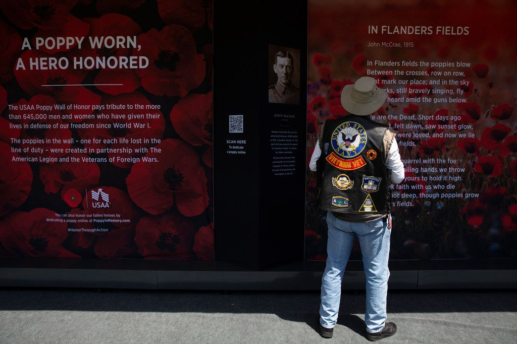 A Vietnam veteran visits the USAA Poppy Wall of Honor on the National Mall in Washington, D.C., May 24, 2019. 645,000 poppies are displayed in the wall for the Memorial Day weekend to commemorate lives lost in service. (AP Photo/Carolyn Kaster)