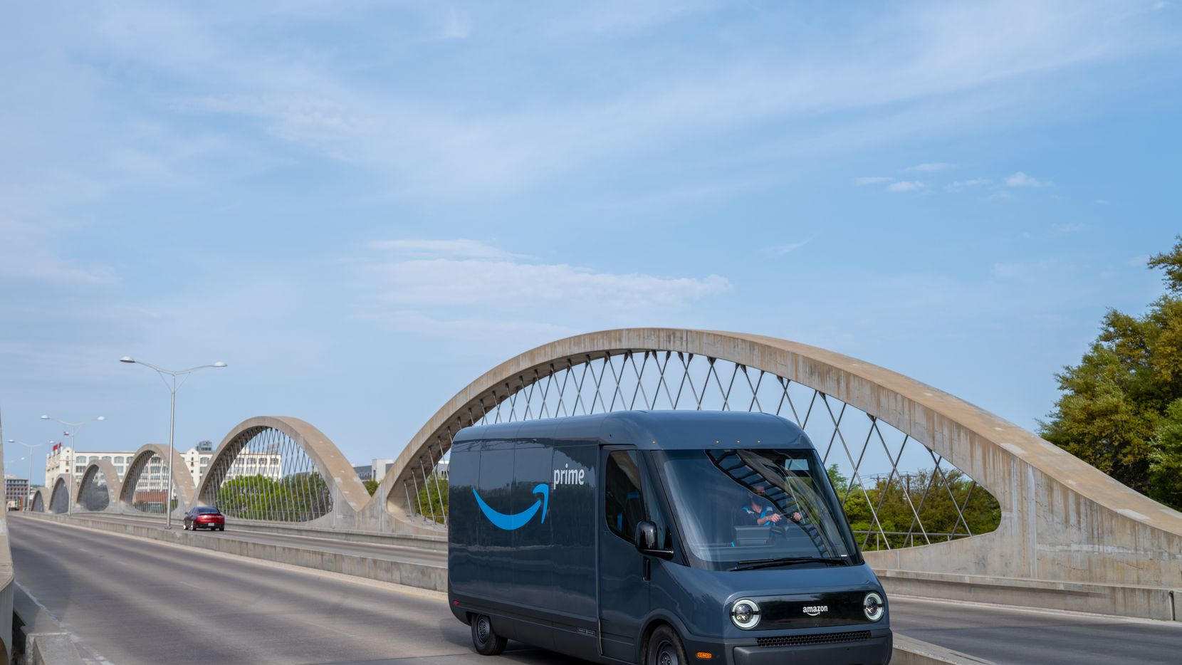 Designed and built in partnership with Rivian, Amazon s first custom electric delivery vehicle was unveiled last fall. Here it is on the Seventh Street bridge in Fort Worth.