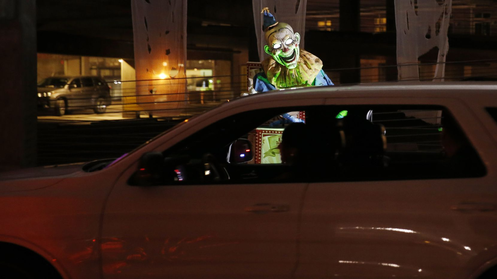 Drivers make their way through the garage during Drive Boo Halloween at American Airlines Center Silver parking garage.