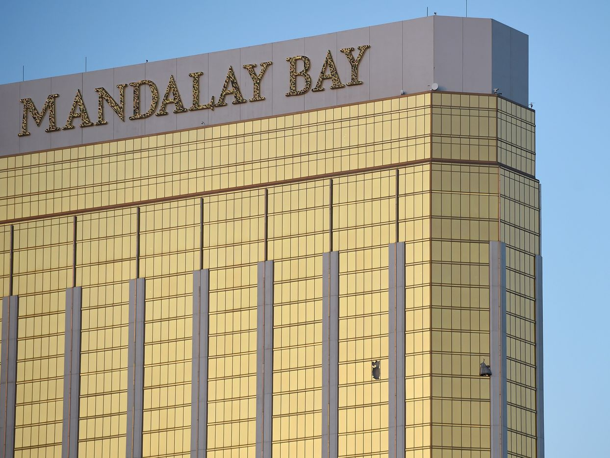 Broken windows are seen on the 32nd floor of the Mandalay Bay Resort and Casino after a lone gunman opened fired on the Route 91 Harvest country music festival on October 2, 2017 in Las Vegas, Nevada.