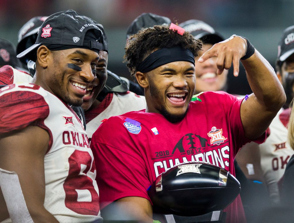 Oklahoma Sooners quarterback Kyler Murray (1) holds up upside down horns after receiving the MVP award after winning the Big 12 Championship football game between the Texas Longhorns and the Oklahoma Sooners on Saturday, December 1, 2018 at AT&T Stadium in Arlington, Texas. The Sooners won 39-27. (Ashley Landis/The Dallas Morning News)