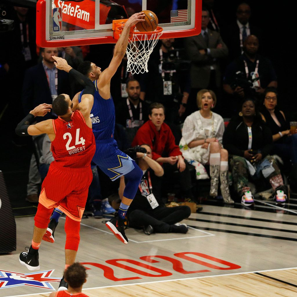 Team LeBron's Ben Simmons (2) dunks in front of Team Giannis' Rudy Gobert (24) during the second half of play in the NBA All-Star 2020 game at United Center in Chicago on Sunday, February 16, 2020. Team LeBron defeated Team Giannis 157-155. (Vernon Bryant/The Dallas Morning News)