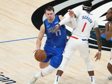 Dallas Mavericks guard Luka Doncic (77) tries to fight his way past LA Clippers guard Reggie Jackson (1) during the first quarter of an NBA playoff basketball game at the American Airlines Center on Friday, June 4, 2021, in Dallas.