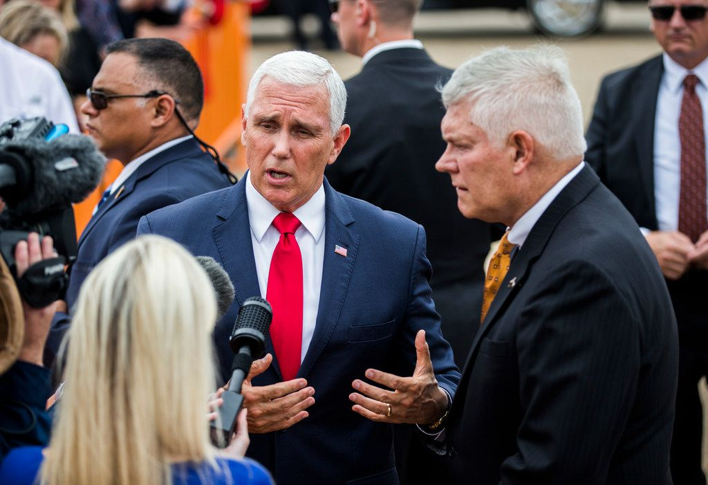 Vice President Mike Pence and U.S. Representative Pete Sessions answer questions from reporters upon arriving in Dallas on Monday, October 8, at Love Field Airport in Dallas. Pence will attend a Pete Sessions for Congress event and a Ted Cruz for Senate event before flying to Missouri later today.