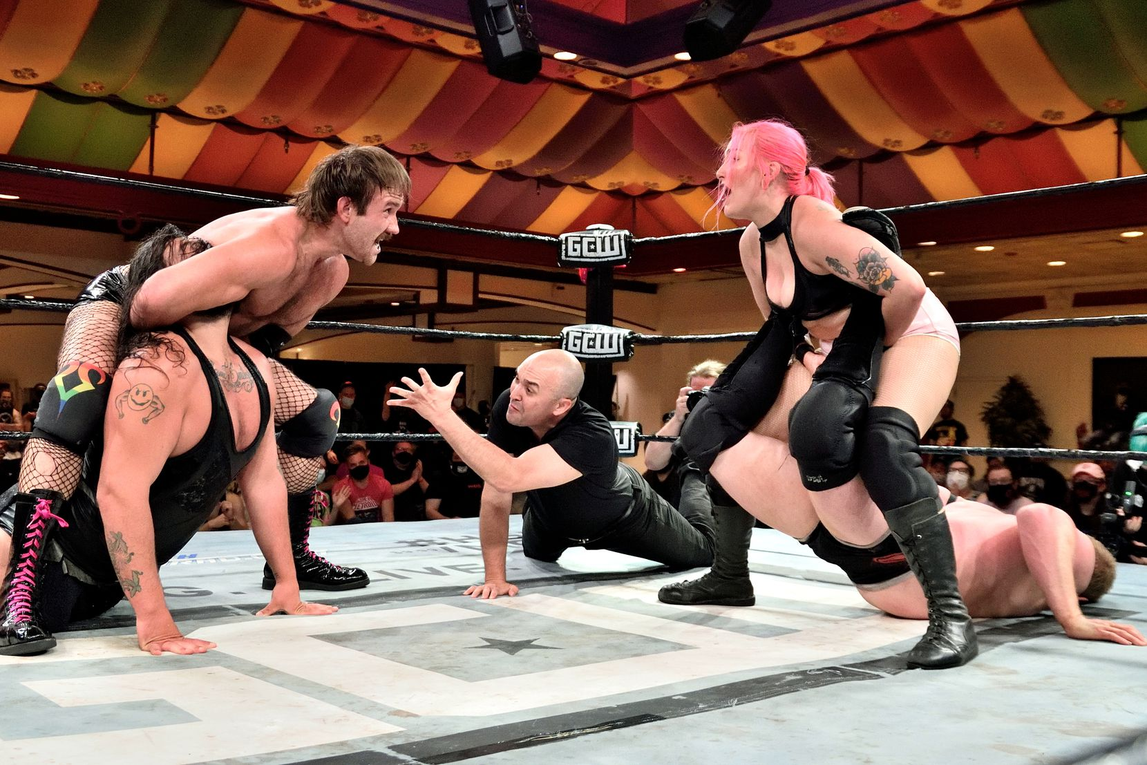 """Professional wrestlers Taylor """"Effy"""" Gibson (left) and Allison """"Allie Katch"""" Woodard (right) apply submission holds to their opponents during a match. (Courtesy: GCW)"""
