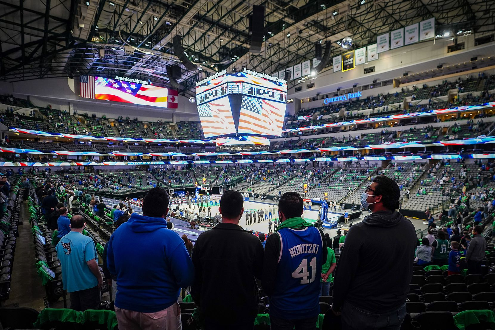 Dallas Mavericks fans stand for the national anthem before an NBA basketball game against the LA Clippers at American Airlines Center on Wednesday, March 17, 2021, in Dallas.